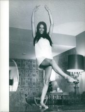"""Pamela Woolman, striking a pose, one  of the ravishing beauties from the film """"Where It's At""""."""