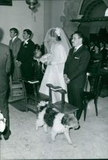 Christine Béranger-Goitschel standing with her groom on the altar during their wedding day.  Taken - May 1966