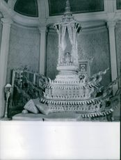 Cambridge Photograph of a woman sitting on her throne in a Palace.