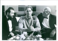 "A photo of Dunn Kevin, Langella Frank and Uline Kevin in a film ""Dave"" 1993"