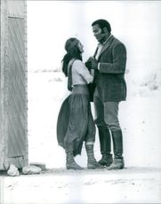 """A photo of Racquel Welch and Jim Brown in a film """"100 rifles""""- July 26, 1968."""