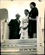 Lord George Brown and Mrs. Brown being welcomed by a Japanese air stewardess