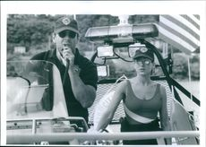 """1993 A scene of Sarah Jessica Parker and Bruce Willis from the American action thriller film """"Striking Distance""""."""