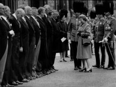 Queen Elizabeth II inspects his company at Windsor Castle