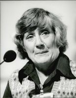 Shirley Williams speaking in a conference.