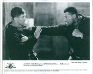 Laurence Fishburne and Stephan Baldwin fighting in the movie,