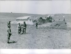 Soldiers standing in the village.