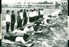 Vietcong students practice shooting before joining the army
