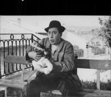 Fernandel with a child in one of his film roles
