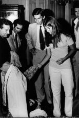 Caroline Kennedy checking cloth.