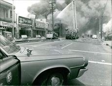 A fire brigade rescuing a burning establishment in Los Angeles.