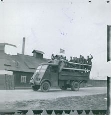 German soldiers on the road with a Norwegian flag in Oslo.
