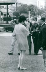 Journalist taking interview and photographs of a famous woman.