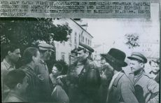 Red Army takes Vilnius: Population of the old Lithuanian Capital Surround Red Army Officers, children and aged people express their gratitude to their liberators.