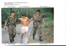 Police arrest one of the 90 vietnamese refugee.