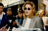 Actress Sharon Stone writes autographs to fans
