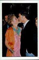 """Sharon Stone kisses make Phil Bronstein during the premiere of her new movie """"Dream Factory"""""""