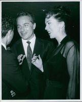 Rossano Brazzi and Lisa Kirk are talking to someone.