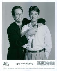 """Gregory Harrison (left) stars as Brandon Theis and Eric Roberts stars as Nick Stark in the film """"It's My Party""""."""