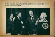 George Walker Bush with his wife and Dan quayle .