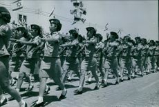 Army lady soldiers marching during the parade in Israel. 1968