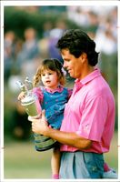 Golfer Ian Baker-Finch shows his trophy to his daughter Hayley