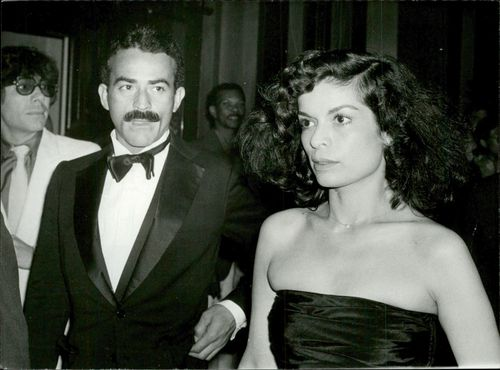 Bianca Jagger together with companion at a party