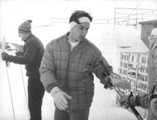 Aga Khan IV collecting equipment for skiing.
