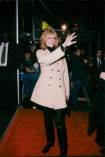 "Julia Roberts arrives at the opening night of Richard Geres movie ""Red Corner"""