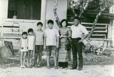 Family posing in vietnam.
