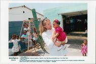German tennis player Steffi Graf in South Africa visits school in Cape Town