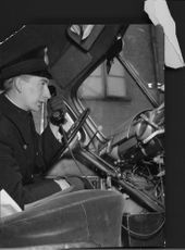 Constable George Heinemann dials the monitoring station from a radio patrol car with new alarm facility