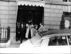 Sophia Loren coming out of a building.