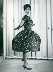 Silvana Pampanini wearing a black dress.