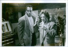 Danny Glover and Martin Short stars in the 1991 film Pure Luck.