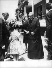 Pope Paul VI talking to children.