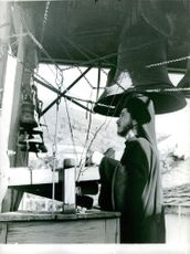 Man ringing the bells in one of the monasteries in Mount Athos, Greece.