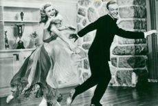 "Ginger Rogers and Fred Astaire dance in ""Carefree"""
