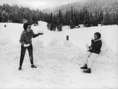 Princess Soraya playing with prince Orsini with snow.