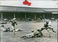 U.S. Soldiers Perflex Britons With American Football In London.