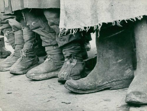Dirty boots of a German prisoners