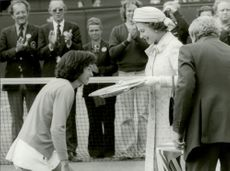 Queen Elizabeth handed the championship trophy to Virginia Wade after the win in Wimbledon