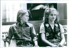 """1994 A scene of Austin Taylor O'Brien and Anna Chlumsky siting together from the  comedy-drama film """"My Girl 2 """"."""