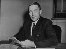 Ancher Nelsen at his desk, in the office.