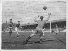 Goalkeeper trying to save the goal during a match between Sweden and Norway.  - 1945