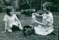Santina and Giuseppina Foglia playing in the park. 1966.