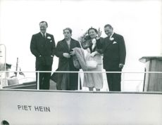 Rene Coty on ship with friends.