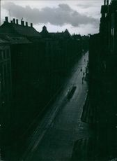 Aerial view of a street, people passing by.1945
