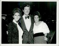 """Roger Moore with his wife Luisa and Rachael Roberts arrives at the premiere of the movie """"Staircase"""" at the Carlton Theater"""