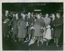 Stanley Baldwin standing with other people and looking towards the camera.
